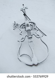 Product like a violin under snow in winter