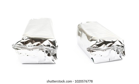 Product packed in a silver foil package isolated over the white background , set of several different foreshortenings