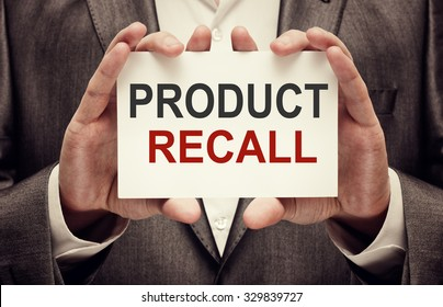 Product Recall. Man holding a card with a message text written on it