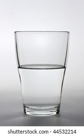 product shot of an half full water glass