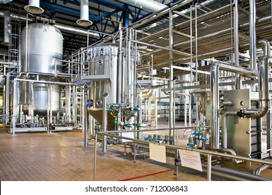 Production of beer: steel reservoirs and pipes in a brewery