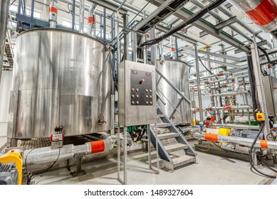 Production of chemical emulsions for mining. Clean chemical workshop. Many different pipelines and tanks.