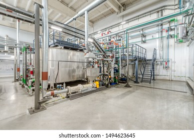 Production of chemical emulsions for mining. Clean chemical workshop. Many different pipelines and tanks. A lot of clean and shiny pipelines, taps, valves.