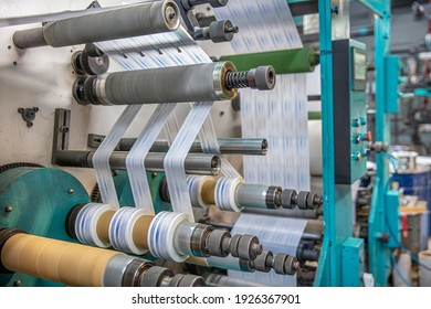 Production of duct tape.Packing tape manufacturing. Strapping Machine for Industrail Packaging Line, Modern machine for packaging line in factory, Industrial and technology concept.