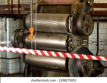 Production equipment rollers are fenced with protective tape, an investigation is underway, an incident, an industrial accident, danger, workshop