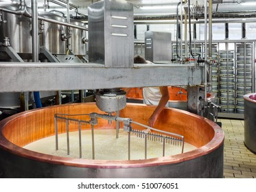 Production of Gruyere de Comte Cheese at the French dairy in Franche Comte, Burgundy, in France.