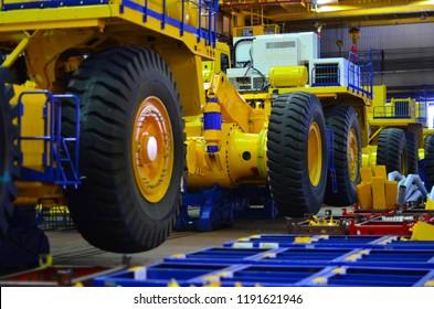 Production of heavy quarry dump trucks. Huge car tire. Truck conveyor