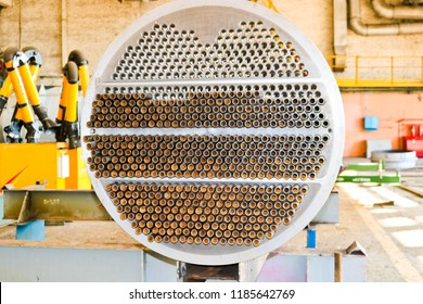 Production of a large tube bundle for a shell-and-tube heat exchanger in an industrial production room of a shop with equipment at an oil refinery, petrochemical, chemical plant, enterprise.