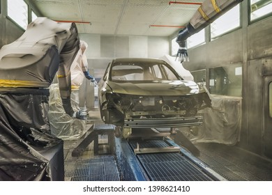 Production line of automobile plant, paint shop. Car body after applying the base paint.