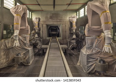 Production line of automobile plant, paint shop. Room with robotic painting system