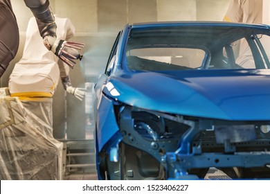 Production line of automobile plant, paint shop. Car body after applying the base paint.