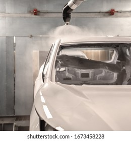 Production line of automobile plant, paint shop. The body of the car after applying the varnish.