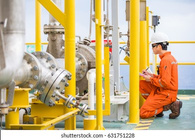 Production operator checking condition of crude oil pump and electric motor to monitor abnormal condition and log data in daily log sheet.