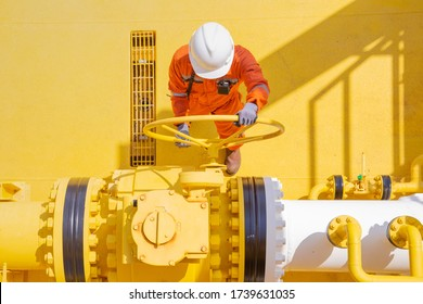 Production operator opening valve on offshore oil and gas central processing platform to control gas and crude production and quality.