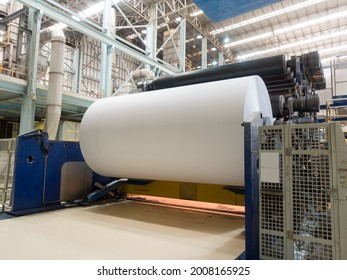 The production of paper rolls in a printing plant, recycling of waste paper.