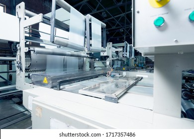 production of plastic packaging film on the automatic packing machine in food product factory. industrial and technology concept.
