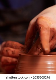 production process of pottery. Forming a clay teapot on a potter's wheel.