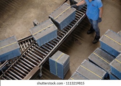 Production process, Worker working with conveyor belt.