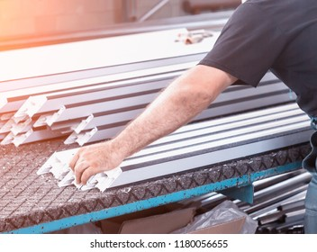 Production of pvc windows, a man removes measurements from a pvc frame, manufacturing windows pvc, measure