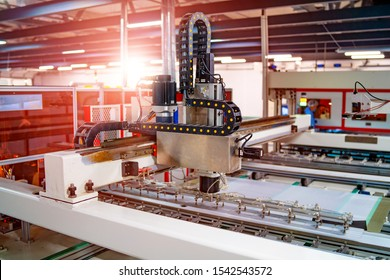 Production of solar panels. Green energy concept. Modern production factory or plant. Special equipment. Conveyor at workshop. Closeup.