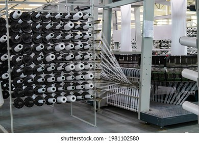 Production of white polypropylene flat yarn for the production of industrial bags. Allison-circular loom woven bag machine. Production of polypropylene sleeves. Shuttle