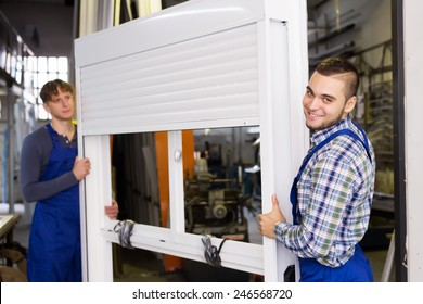 Production workers in coverall with different PVC window with shutter