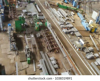 Production workshop of metal products and equipment. Production hall, view from the top / Increased noise and grain.