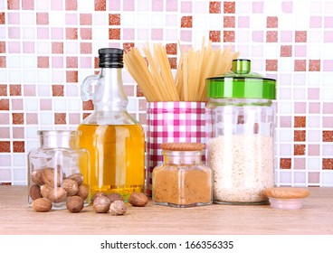 Products for cooking in kitchen on table on mosaic tiles background
