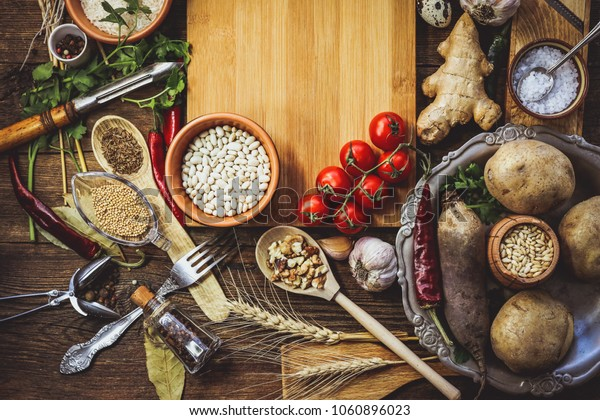 products for cooking, vegetables, ingredients, spices. place for text. wooden plank. food background.
