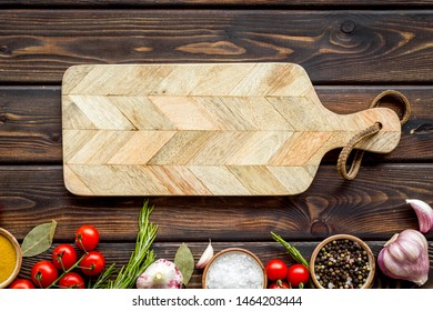 Products frame and cutting board on wooden background top view mockup