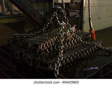 Products machine factory - conveyor chains. Chain has just been soaked in engine oil for lubrication and corrosion protection during storage.