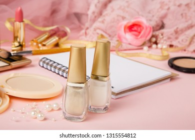 Products for manicure or nail art and other cosmetics. Nail polish on  romantic pink tulle background. Women's secrets. Pink and golden colors. Decorative cosmetics