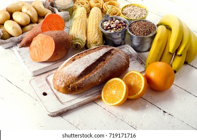 Products rich of carbohydrates. Healthy eating on a white wooden table.