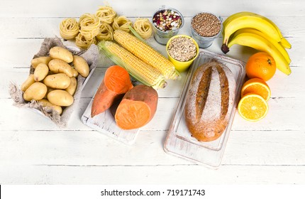 Products rich of carbohydrates. Healthy eating on a white wooden table. Top view