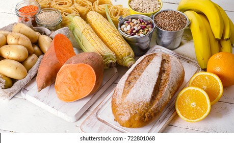Products rich of carbohydrates. Healthy eating on white wooden table.