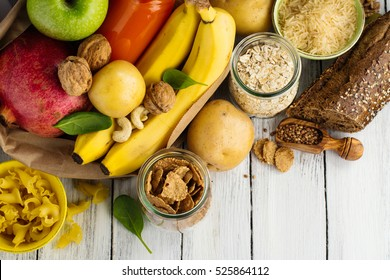 Products rich of complex carbohydrates. Healthy food on wooden background. Space for text