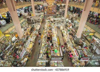 The products in shops and people in the grand market in Thailand. This market we call Warorot market (Thai name) in Chiang Mai province ,Thailand.   I took this picture on 16 June 2016 around 2.00 PM.