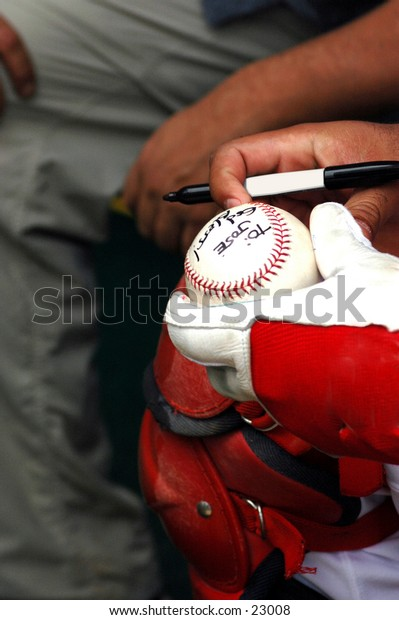 Professianl ball player signs an autograph