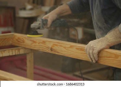 Profession, carpentry and woodwork concept.Carpenter, joiner at work in the workshop. Man at work on wood.