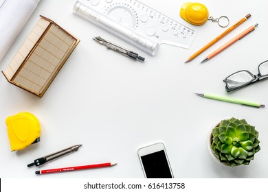 profession concept with architect desk and tools white background top view mock-up