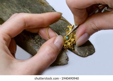 Profession jeweler. Hands of an jeweller . Craft jewelry making. Handwork . Close up.