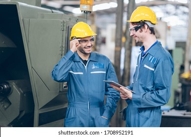profession technician engineer and Apprentice operate heavy machine to automated CNC in factory