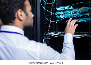 Professional IT administrator checking internet cables