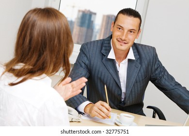 Professional advisor having a discussion with a customer