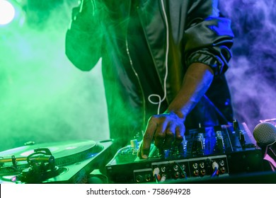 professional african american club DJ with sound mixer on concert