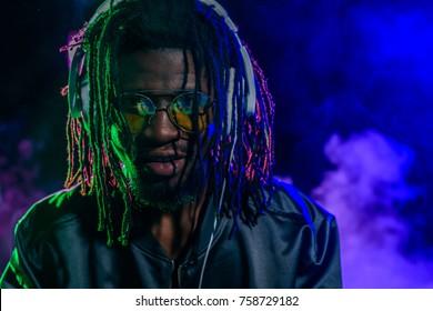 professional african american club DJ in headphones