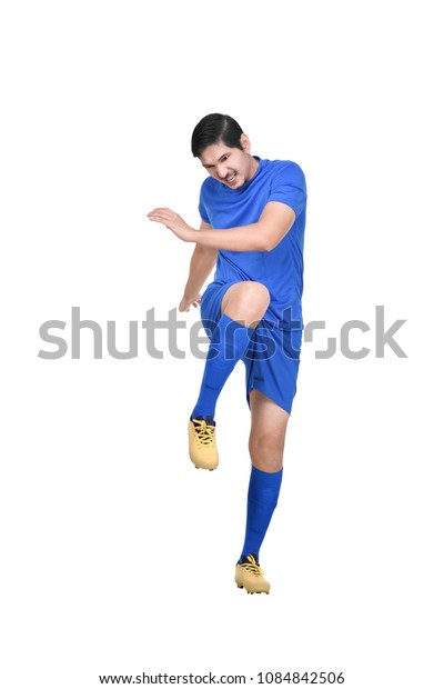 Professional asian footballer kick the ball isolated over white background