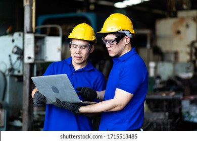 Professional Asian team engineering Man Worker at industrial factory wearing uniform and hardhats at Metal lathe industrial manufacturing factory. Engineer Operating  lathe Machinery