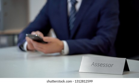 Professional assessor using smartphone, expert checking situation on market