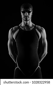 Professional athlete swimmer studio portrait against black background. Black and white image.